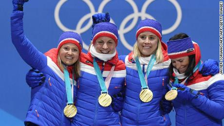 Norway's Ingvild Flugstad Oestberg, Astrid Uhrenholdt Jacobsen, Ragnhild Haga and Marit Bjeorgen pose on the podium during the medal ceremony for the cross country women's 4x5km relay.