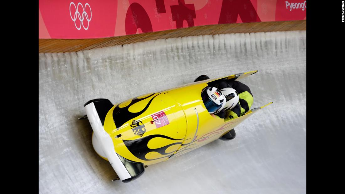 Francesco Friedrich pilots a four-man bobsled for Germany. Friedrich's team leads halfway through the competition.
