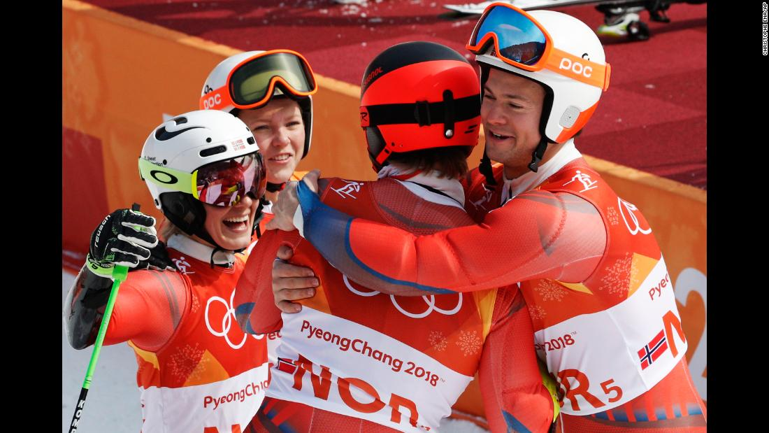 Norwegian skiers celebrate winning bronze in the team event. It was Norway's 38th medal of these Olympics, which breaks the record for most medals won by one country during a single Winter Games.