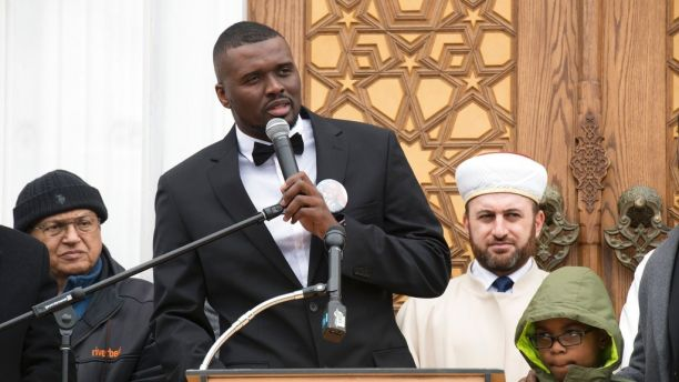 Prince George's County Police Officer Mujahid Ramzziddin's son Eric Tyler gives remarks about his father's life during a memorial service, Friday, Feb. 23, 2018 at the Diyanet Center of America in Lanham, Md. Prince George's County police say 37-year-old Glenn Tyndell shot Cpl. Mujahid Ramzziddin five times with a shotgun Wednesday when the off-duty officer attempted to intervene in a dispute between Tyndell and his wife.(Marvin Joseph/The Washington Post via AP)