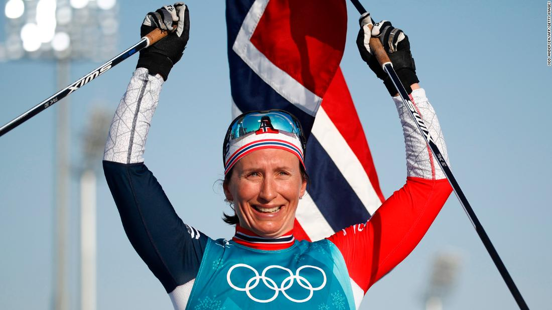 Norwegian cross-country skier Marit Bjørgen celebrates after winning the final event of these Olympics. She finished with five medals in Pyeongchang and is the most decorated Winter Olympian of all time (15 medals in all).