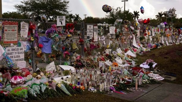 A rainbow is seen over the memorial outside of Marjory Stoneman Douglas High School in Parkland Fla., Monday, Feb. 26, 2018. (Joe Cavaretta /South Florida Sun-Sentinel via AP)