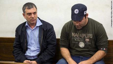 Shlomo Filber, left, sits at the Magistrate Court during his remand in Tel Aviv on February 18.