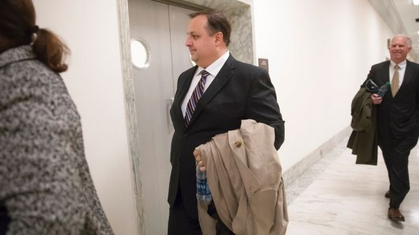 FILE - In this Jan. 23, 2017 file photo, Walter Shaub Jr., director of the U.S. Office of Government Ethics walks on Capitol Hill in Washington. Shaub, who prodded President Donald Trump's administration over conflicts of interest is resigning to take a new job, at the Campaign Legal Center, a nonprofit in Washington that mostly focuses on violations of campaign finance law. (AP Photo/J. Scott Applewhite, File)