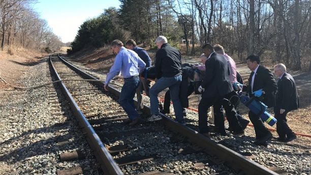 Emergency first responders and passengers from an Amtrak passenger train carrying Republican members of the U.S. Congress from Washington to a retreat in West Virginia carry one of the injured across train tracks to an ambulance after the train collided with a garbage truck in Crozet, Virginia, U.S. January 31, 2018.   Justin Ide/Crozet Volunteer Fire Department/Handout via REUTERS  ATTENTION EDITORS - THIS IMAGE WAS PROVIDED BY A THIRD PARTY. - RC1226D03D40