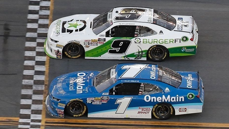 Tyler Reddick (9) beats teammate Elliott Sadler (1) at the NASCAR Xfinity Series race at Daytona International Speedway.