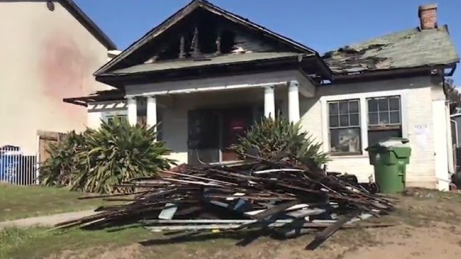 Neighbors living around a home that burned down in Los Angeles a week ago suspect squatters started the fire.