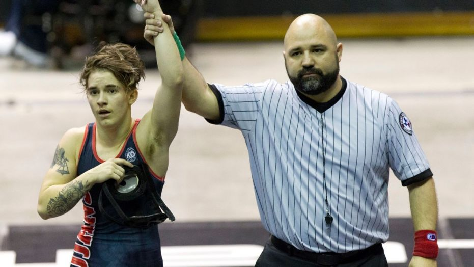 Mack Beggs of Euless Trinity defeated Chelsea Sanchez of Morton Ranch to defend his Class 6A girls 110-pound title during the UIL State Wrestling Championships at the Berry Center