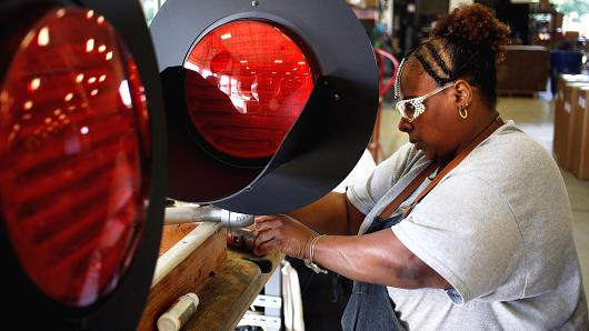 A worker assembles railroad crossing signals at the Siemens Rail Automation manufacturing facility in Louisville, Kentucky.