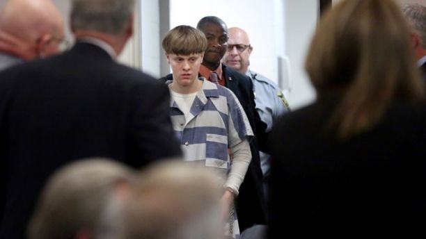 Dylann Roof is escorted into the court room at the Charleston County Judicial Center to enter his guilty plea on murder charges in state court  for the 2015 shooting massacre at a historic black church, in Charleston, South Carolina, April 10, 2017.  REUTERS/Grace Beahm/Pool - RTX34ZJW
