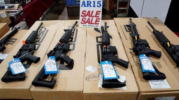 AR-15 rifles are displayed for sale at the Guntoberfest gun show in Oaks, Pennsylvania, U.S., October 6, 2017.   REUTERS/Joshua Roberts - RC120D41AB00