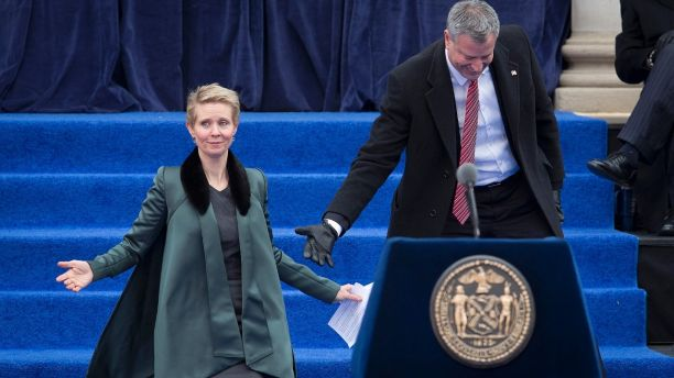 Actress Cynthia Nixon is helped down the stairs by new mayor Bill de Blasio's during his inauguration ceremony for the mayor of New York at City Hall in New York January 1, 2014. Bill de Blasio was formally inaugurated as New York City's 109th mayor on Wednesday at a City Hall ceremony where he promised to take