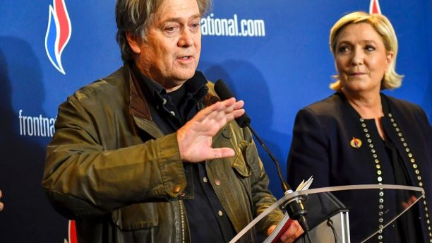 Former White House strategist Steve Bannon holds a press conference with National Front party leader Marine Le Pen, right, at the party congress in the northern French city of Lille, Saturday, March 10, 2018. Steve Bannon has given a big boost to French far right leader Marine Le Pen, telling a cheering crowd at a congress of her National Front party that