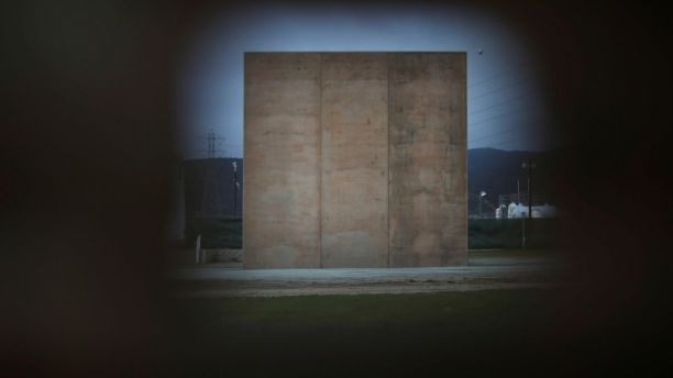 A prototype for U.S. President Donald Trump's border wall with Mexico is seen through a hole in the the current border fence, in this picture taken from the Mexican side of the border in Tijuana, Mexico March 12, 2018. REUTERS/Edgard Garrido - RC11C9B77430