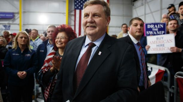 Republican Rick Saccone looks to the stage and President Donald Trump at a campaign rally at Atlantic Aviation in Moon Township, Pa., Saturday, March 10, 2018. Saccone is running against Democrat Conor Lamb in a special election being held on March 13 for the PA 18th Congressional District vacated by Republican Tim Murphy. (AP Photo/Carolyn Kaster)
