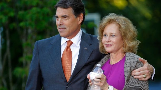Republican presidential candidate Texas Governor Rick Perry (L), stands with his wife Anita, as he is introduced at a house party in Greenland, New Hampshire, in this August 13, 2011 photograph. During two decades in Austin, the Texas capital, Anita Perry has taken good advantage of the opportunities presented by her husband's political rise, traveling worldwide to promote the state and enjoying access to Texas' movers and shakers. The first Texas first lady to work full-time, she left nursing for a series of jobs intertwined with the policy and politics of state government. Picture taken August 13, 2011. To match Special Report CAMPAIGN/ANITAPERRY REUTERS/Brian Snyder (UNITED STATES - Tags: POLITICS) - GM1E7AI0B3G01
