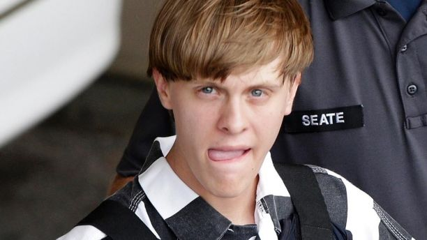 FILE - In this June 18, 2015, file photo, Charleston, S.C., shooting suspect Dylann Storm Roof is escorted from the Cleveland County Courthouse in Shelby, N.C.   Solicitor Scarlett Wilson told The Associated Press on Friday, March 31, 2017,  that Roof is scheduled to enter a guilty plea during a hearing on April 10 in Charleston. The plea on all of his state charges, including nine counts of murder, comes in exchange for a sentence of life in prison, the prosecutor said. Roof has been awaiting trial on state murder charges for the deaths of nine black parishioners at Charleston's Emanuel AME Church in June 2015. (AP Photo/Chuck Burton, File)