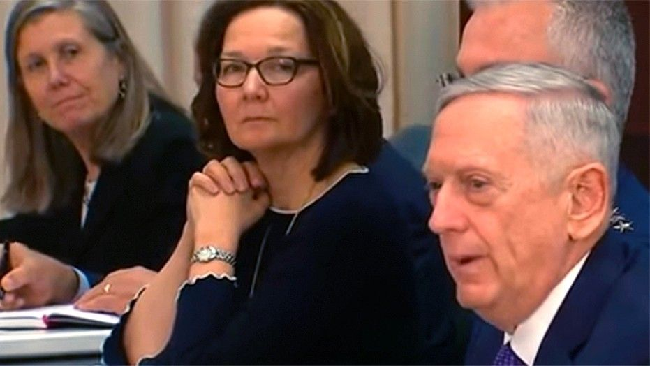 Gina Haspel, center, a career spymaster, will still need to be confirmed as the CIA's new director. She previously served as the agency's deputy director under Mike Pompeo, who was tapped to be Trump's new secretary of state.