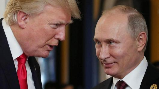 US President Donald Trump and Russia's President Vladimir Putin at the APEC leaders' summit on November 11, 2017.