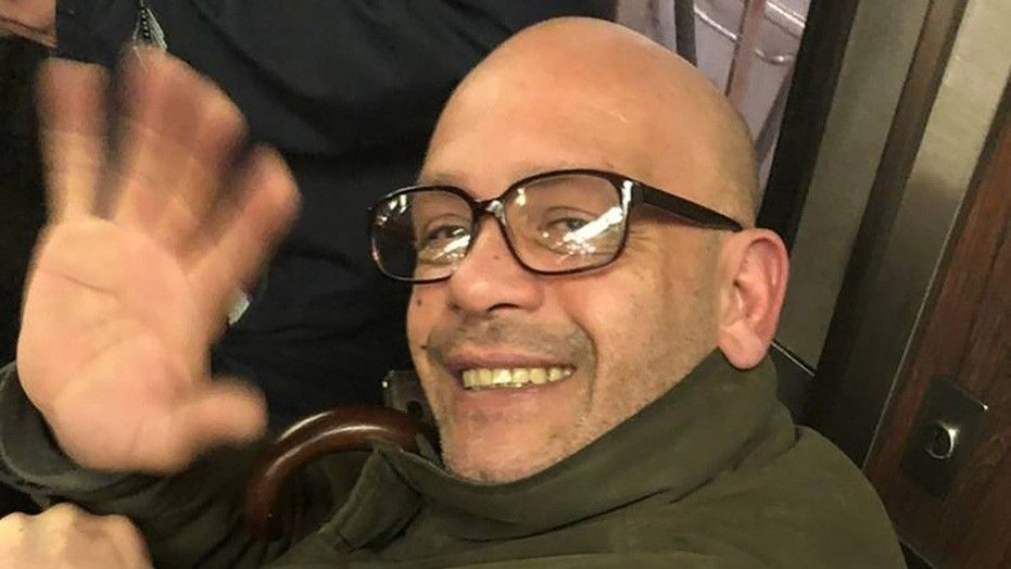 New York City police accused George Matias of smiling and waving to a woman who snapped his photo when he allegedly exposed himself.