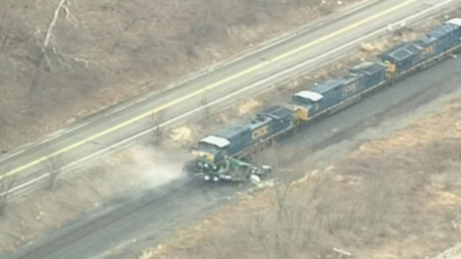 Evacuations were ordered in a Pennsylvania neighborhood after a train collided with a truck carrying hydrochloric acid.
