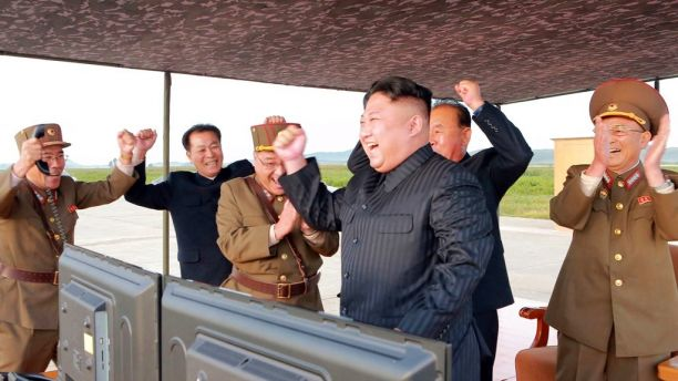 In this undated photo distributed on Saturday, Sept. 16, 2017, by the North Korean government, North Korean leader Kim Jong Un, center, celebrates what was said to be the test launch of an intermediate range Hwasong-12 missile at an undisclosed location in North Korea. Independent journalists were not given access to cover the event depicted in this image distributed by the North Korean government. The content of this image is as provided and cannot be independently verified. (Korean Central News Agency/Korea News Service via AP)