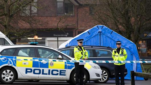 Police officers man a cordon near a forensic tent (not pictured) where a man and woman had been found unconscious two days previosly, on March 6, 2018 in Salisbury, England.