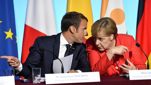 French President Emmanuel Macron and German Chancelor Angela Merkel during a press conference at Elysee Palace on August 28, 2017 in Paris, France.